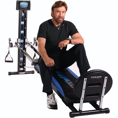 Chuck Norris sits on his Total Gym